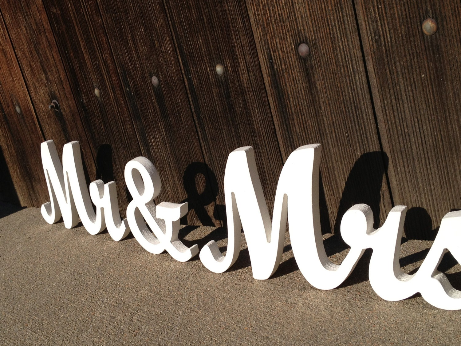 Mr. And Mrs. wooden signs in elegant script font for by TheLettery