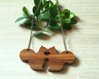 Squirrel necklace wood.  There's too much love around these little squirrels.