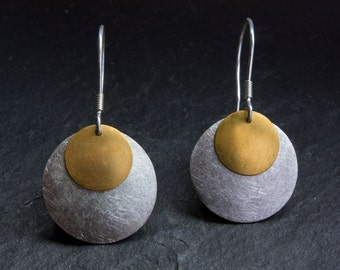 Circle earrings made from gold 900 (about 22k) and sterling silver. Handmade fine jewelry.