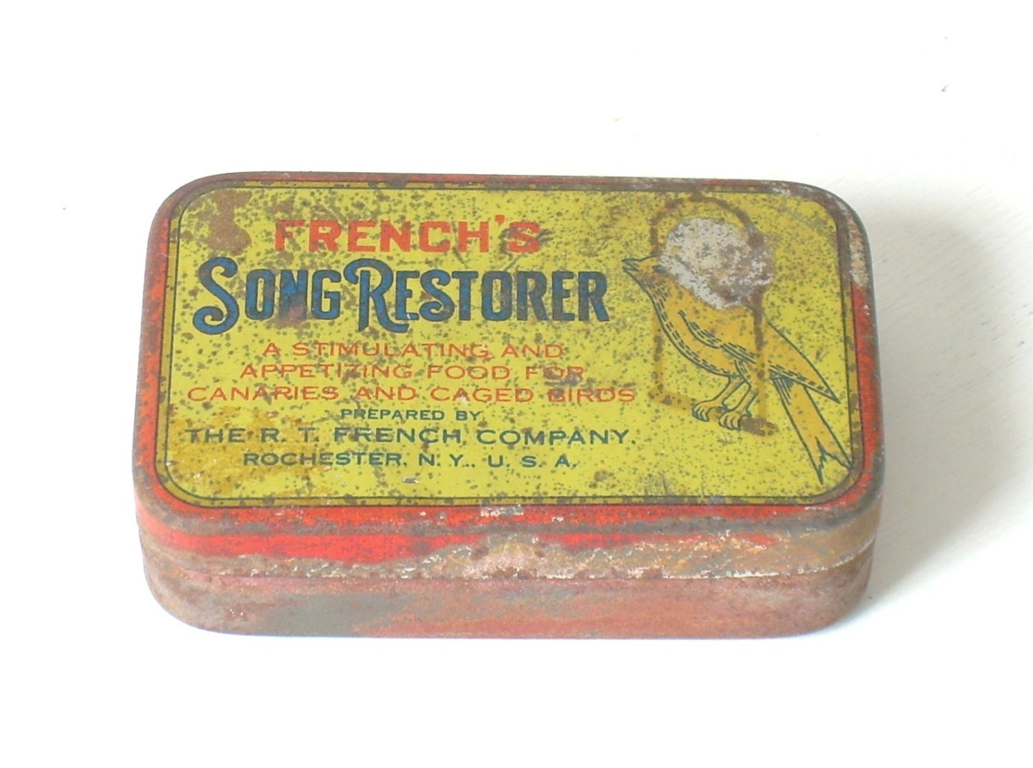 Vintage french 39 s song restorer bird food tin for Bird feed tin