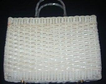 Vintage white straw handbag with lucite handle.