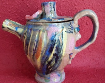 A playful ceramic teapot for brewing tea essence or a full pot of tea by Gloria Moses