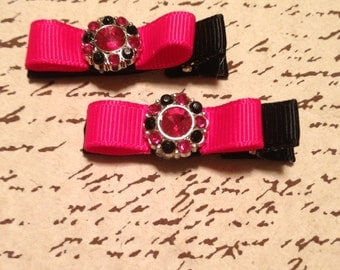Hot pink and black bow hair clip with embellishment