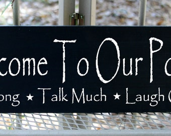 Welcome to our porch, sit long, talk much, laugh often wood sign