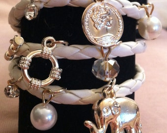 Wrap braided charm bracelet with gold charms and toggle closure