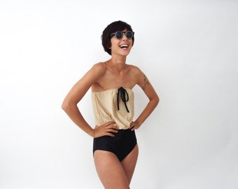 One Piece swimsuit in Gold and Black with Strapless Cleavage in Retro Style