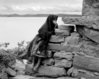 Quecha Woman Waiting for Her Husban to Return: Traditional Clothes, Stonework, Peru