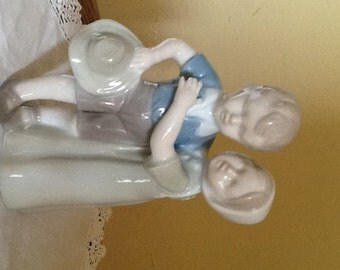 Vintage Adorable figurine of a young boy and girl holding each other-Global Art Japan