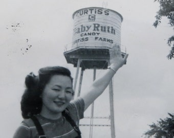 1950's Tallest Girl In Town Touches The Baby Ruth Candy Water Tower Snapshot Photograph - Free Shipping