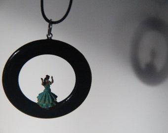 Pendant with a grenn gypsy (5.5cm diameter)