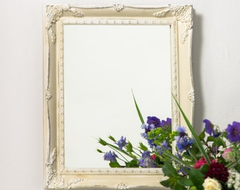 Beautifull French vintage hand painted mirror hand painted in white and cream and also in a hand gilded antique gold hand made in England