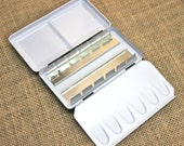 New Empty Metal Watercolor Paint Box that can hold up to 12 half pans of watercolor paint