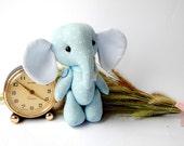 Little pretty blue elephant. Cloth art doll. Teddy toys.