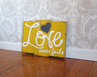 Love Never Fails Reclaimed Mustard and Charcoal Wooden Plank Distressed Wood Sign Wall Decor