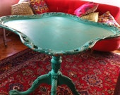 Bright turquoise display table