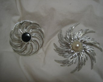 Vintage big Swirl/silver sunburst pins; two starburst pins