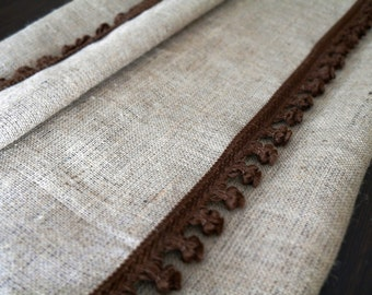 """Burlap Curtain 68"""" x 84""""  with a chocolat pom fringe in both sides of curtain."""