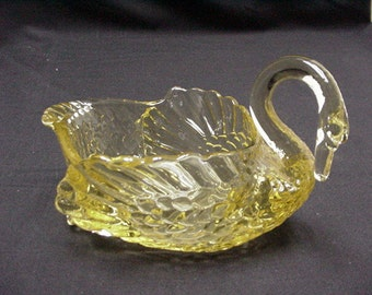 An antique Cambridge glass swan.