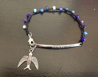 Peace soaring bird in the sky bracelet blue