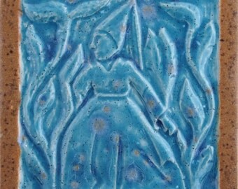 Tile with picture of woman in the Middle Ages