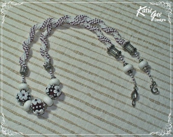 131 White & Amethyst Woven Necklace with featured lampwork beads