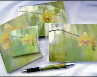 Sunshine Orchid 10 Notecards, 10 postcards, pen, 1 notepad, 1 sticky note pad comes as a set. A Beautiful Orchid, yellows, greens, golds.
