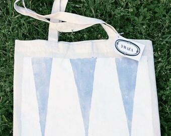 Sac cabas blanc à triangles argentés