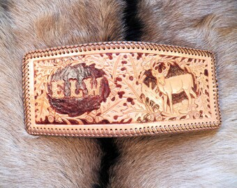 Custom hand tooled leather wallet.