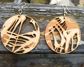 Laser cut and etched basswood earrings, cut from original handcut design