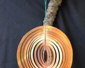 Handcut copper tree hanging.