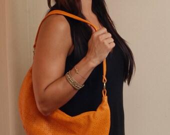 Orange lambskin purse, laser cut design, zipper closure.