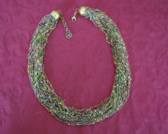 ON SALE. Multi-colored multiple strings of glass beads necklace in soft pinks and greens.