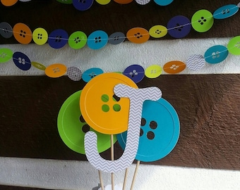 Cute as a button centerpiece with matching 10ft garland