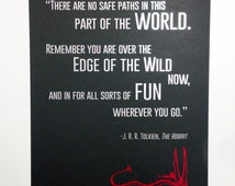The Hobbit inspired art print with a quote from the book printed in silver foil, with a shiny red Smaug