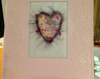 pretty pastel felted heart with embellishments in decorated pink frame