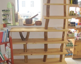 natural wood shelf with branches