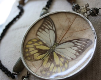 The Entomology Collection---Vintage Assemblage Butterfly Under Glass Necklace with Horsehair Chain and Paris France Advertising