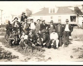 Vintage photo Big Gang of men workers waiting
