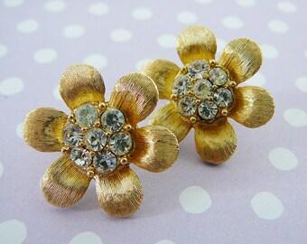 Vintage .. Crown Trifari Flower Earrings, rhinestone Goldtone Clipon