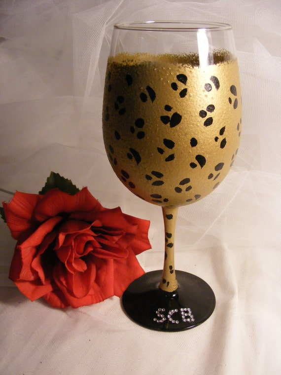Items similar to painted leopard wine glass with bling for Painted wine glasses with initials