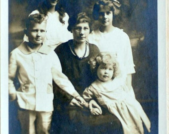 Early 1900s - Family Portrait with Smiling Girl.