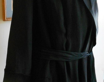 """1920's, 40"""" bust, black silk crepe, with reverse side of silk satin."""