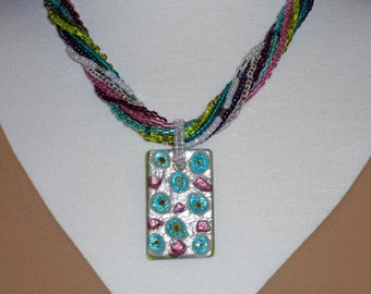 Necklace with silver teal iris Murano pendant and 9 interchangeable beaded necklaces of multiple colors