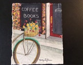 Watercolor print of bicycle at coffee/book shop