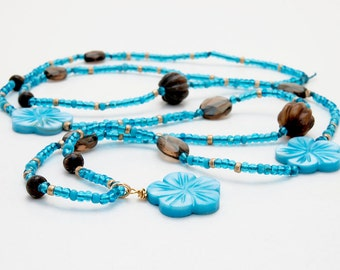 Long necklace in turquoise and brown, with shell flowers, brown gemstones and antique seed beads