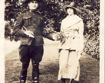 Canadian MOUNTED POLICEMAN Hands Woman a BOUQUET of Flowers Photo Circa 1920s