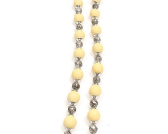 vintage beaded nacklace with small silver beads  and beige