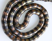 Vintage snake rope necklace with iridescent chunky metal beads. 1970s.