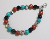 Earth and Sky Bracelet - Red Jasper, Black Onyx, Pewter and Turquoise Magnesite beads