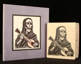 skeleton w/ guitar